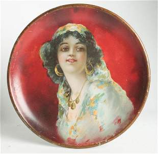 A CIRCA 1905 TIN LITHO PLATE WITH GYPSY GIRL
