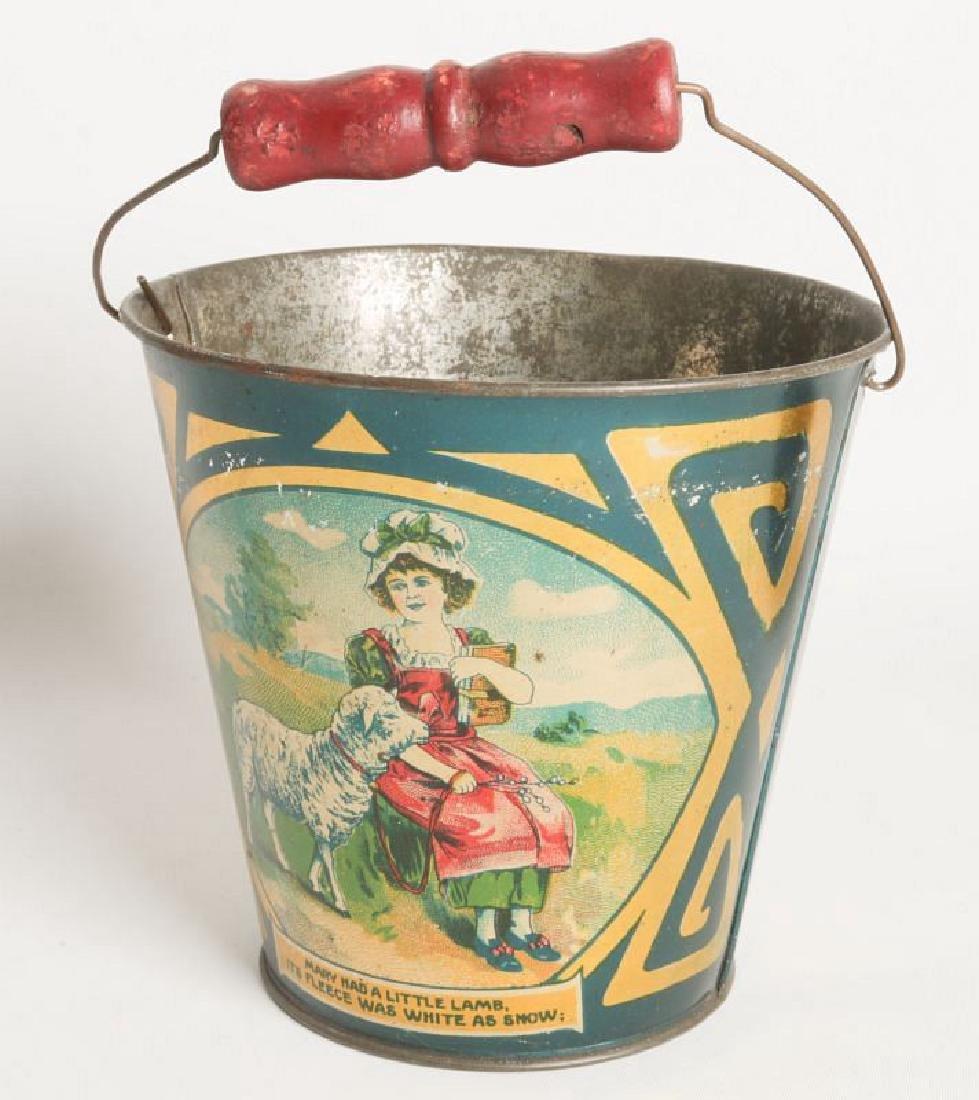 A CIRCA 1905 VICTORIAN CHILD'S TIN LITHO SAND PAIL