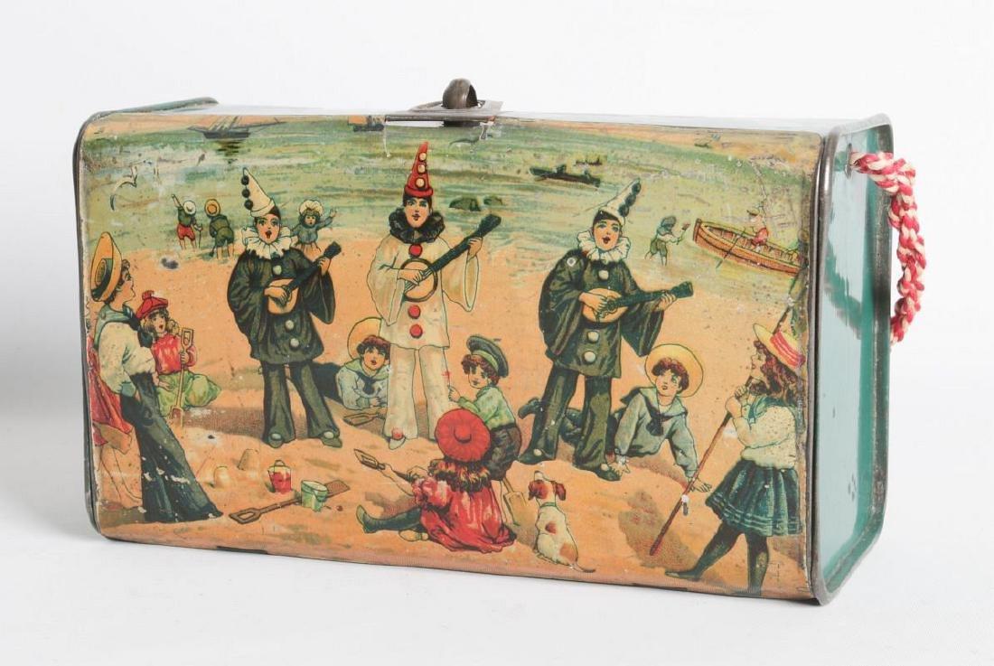 A CIRCA 1910 TIN LITHO LUNCH BOX W/ BEACH SCENE