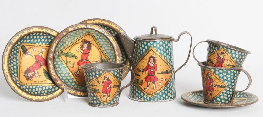 A SCARCE TENNIS PLAYING THEME TIN LITHO TEA SET