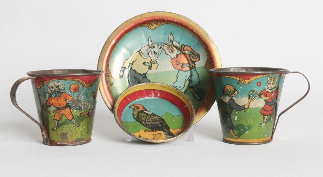 CHILDREN'S TIN LITHO TEA CUPS AND SAUCERS
