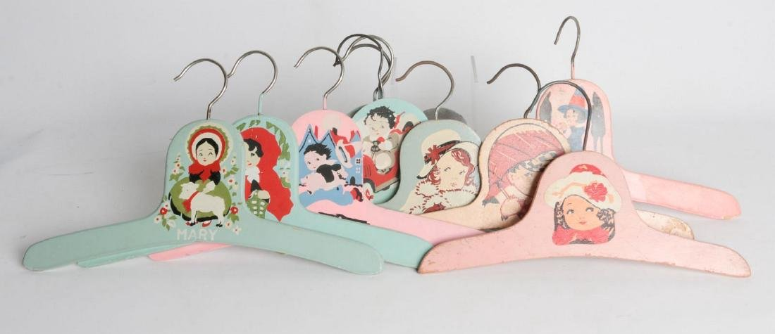 PAINTED 1920s CHILD'S CLOTHES HANGERS WITH FIGURES