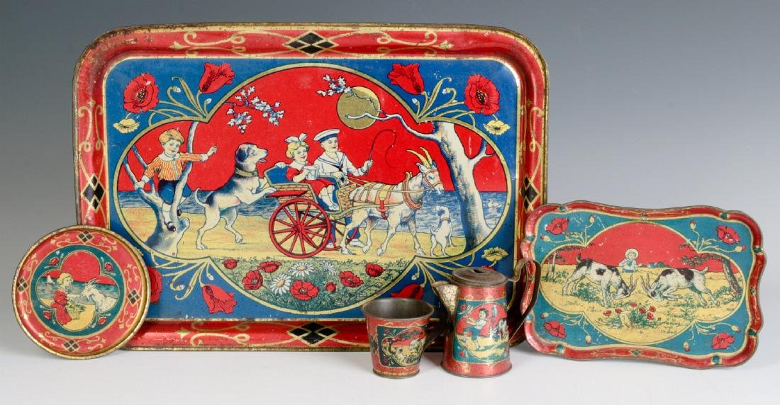 A CHILD'S TIN LITHO TEA SET WITH GOATS & CHILDREN