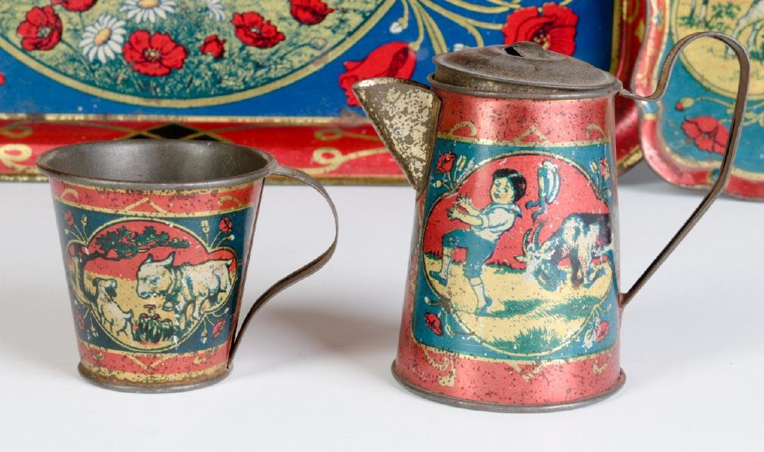 A CHILD'S TIN LITHO TEA SET WITH GOATS & CHILDREN - 3