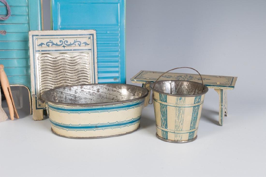 A COLLECTION OF TIN LITHO WASH DAY TOYS CIRCA 1910 - 4