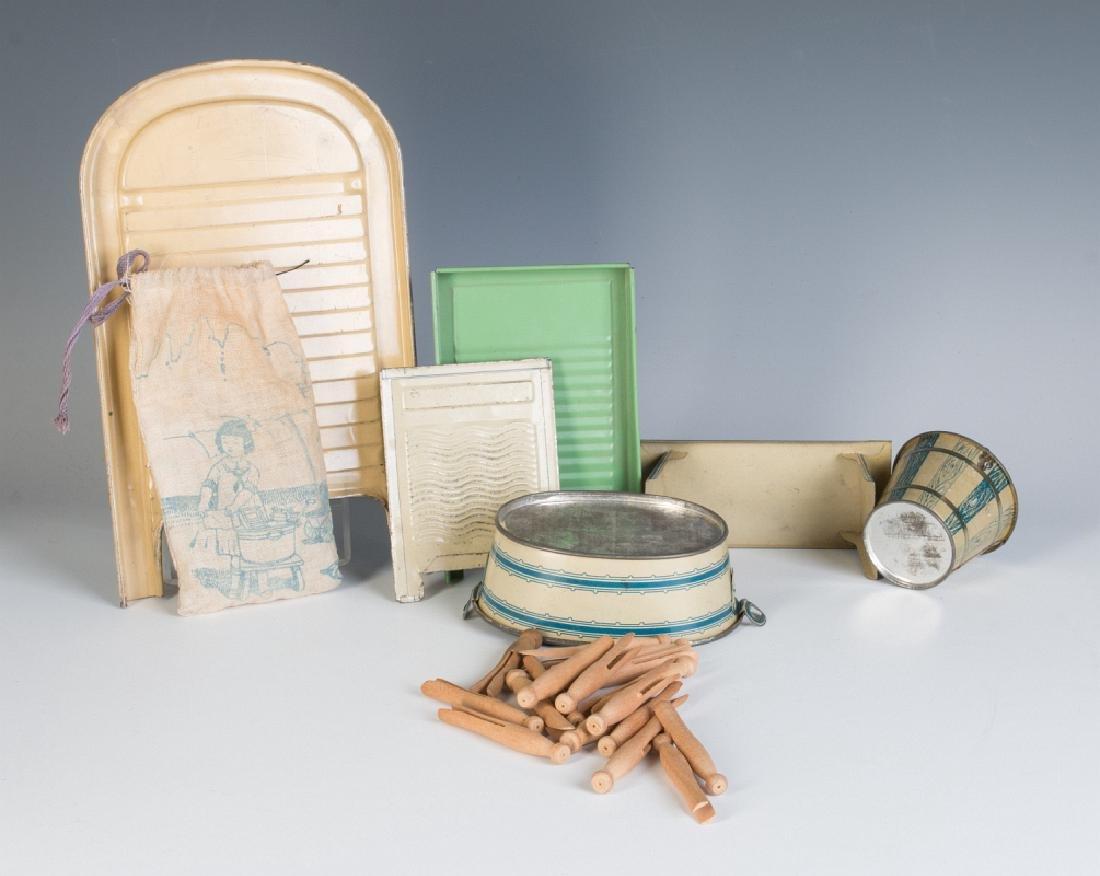A COLLECTION OF TIN LITHO WASH DAY TOYS CIRCA 1910 - 6