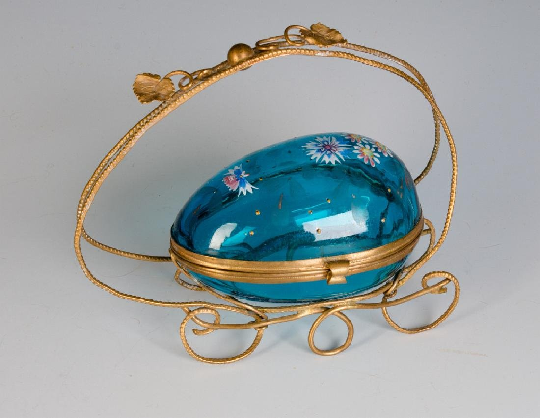 A VICTORIAN GLASS EGG TRINKET BOX IN ORMOLU FRAME
