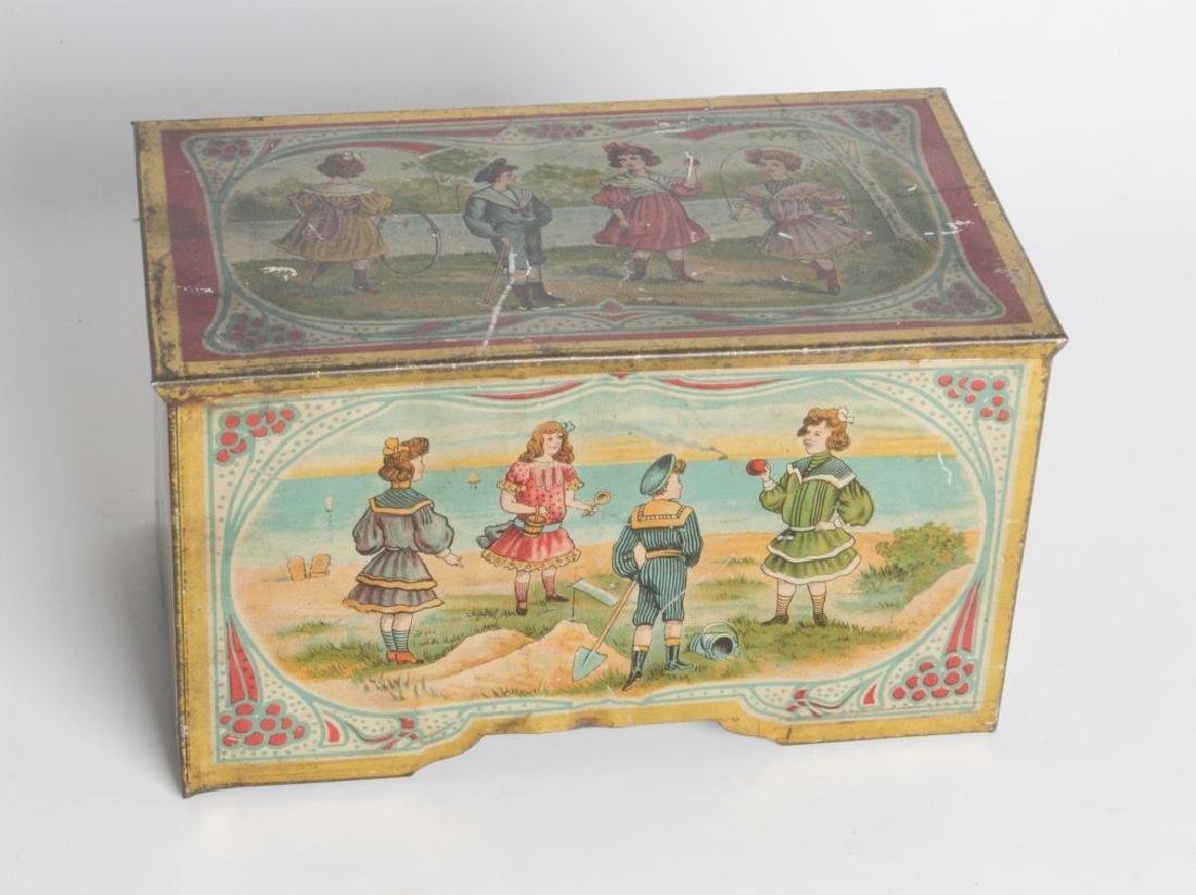 A VICTORIAN TIN LITHO MUSIC BOX