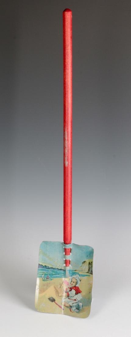 A CHILD'S TIN LITHO SAND SHOVEL WITH WOOD HANDLE - 2