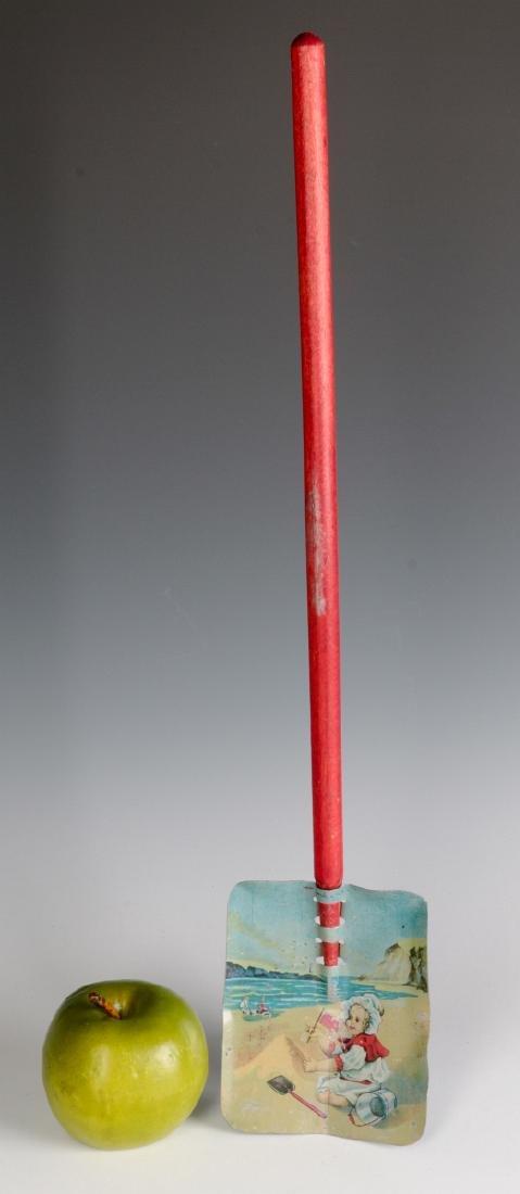 A CHILD'S TIN LITHO SAND SHOVEL WITH WOOD HANDLE - 4