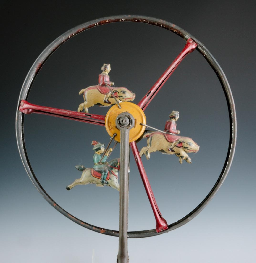 A CHILD'S TIN LITHO ROLL-A-LONG WHEEL TOY C. 1900