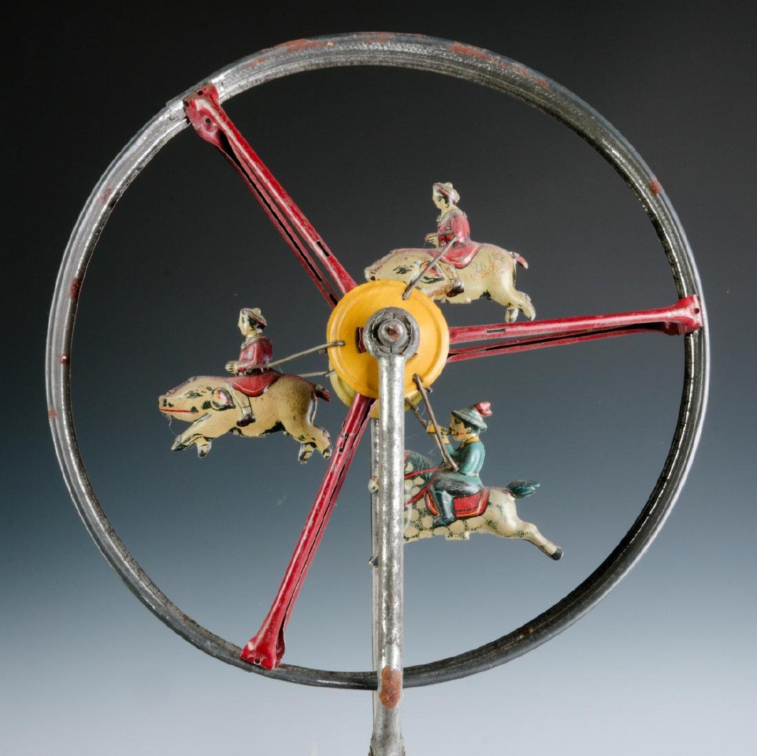 A CHILD'S TIN LITHO ROLL-A-LONG WHEEL TOY C. 1900 - 2