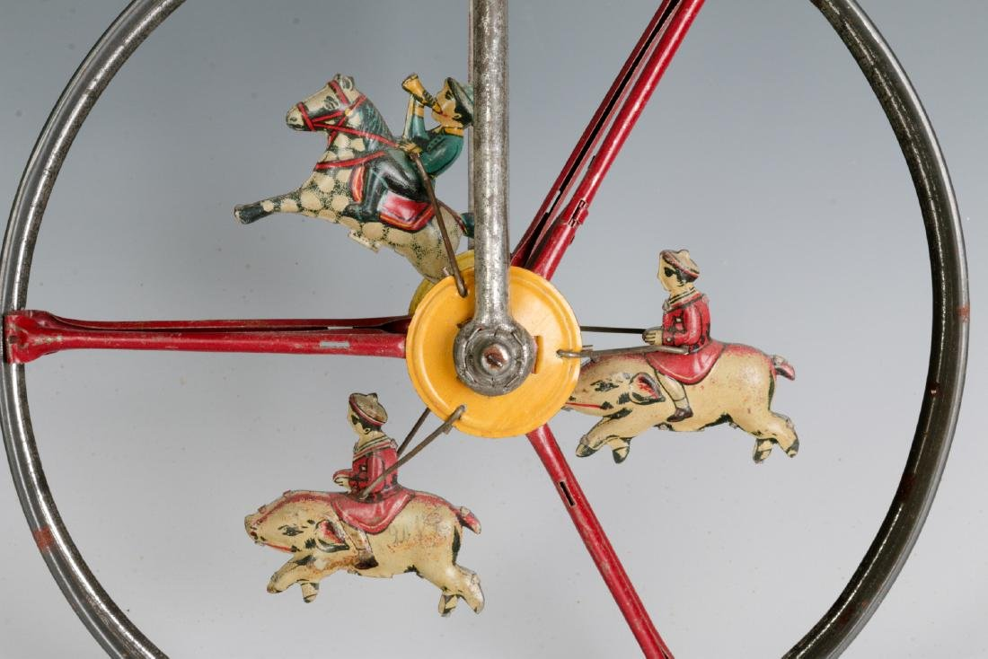 A CHILD'S TIN LITHO ROLL-A-LONG WHEEL TOY C. 1900 - 5