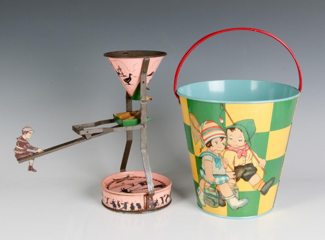 A TIN LITHO SEE-SAW SAND TOY AND NICE CHILD'S PAIL
