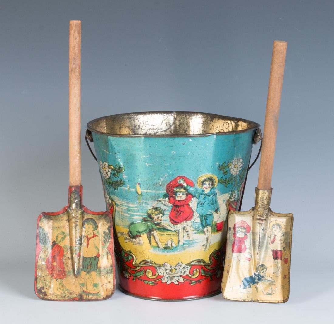 A 19TH CENTURY VICTORIAN SAND PAIL AND TWO SHOVELS