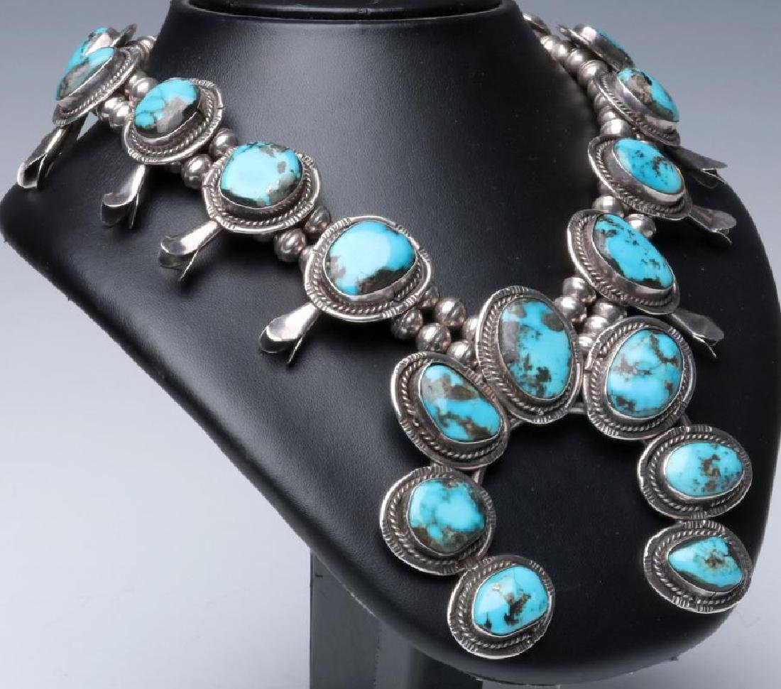A STERLING AND TURQUOISE SQUASH BLOSSOM NECKLACE