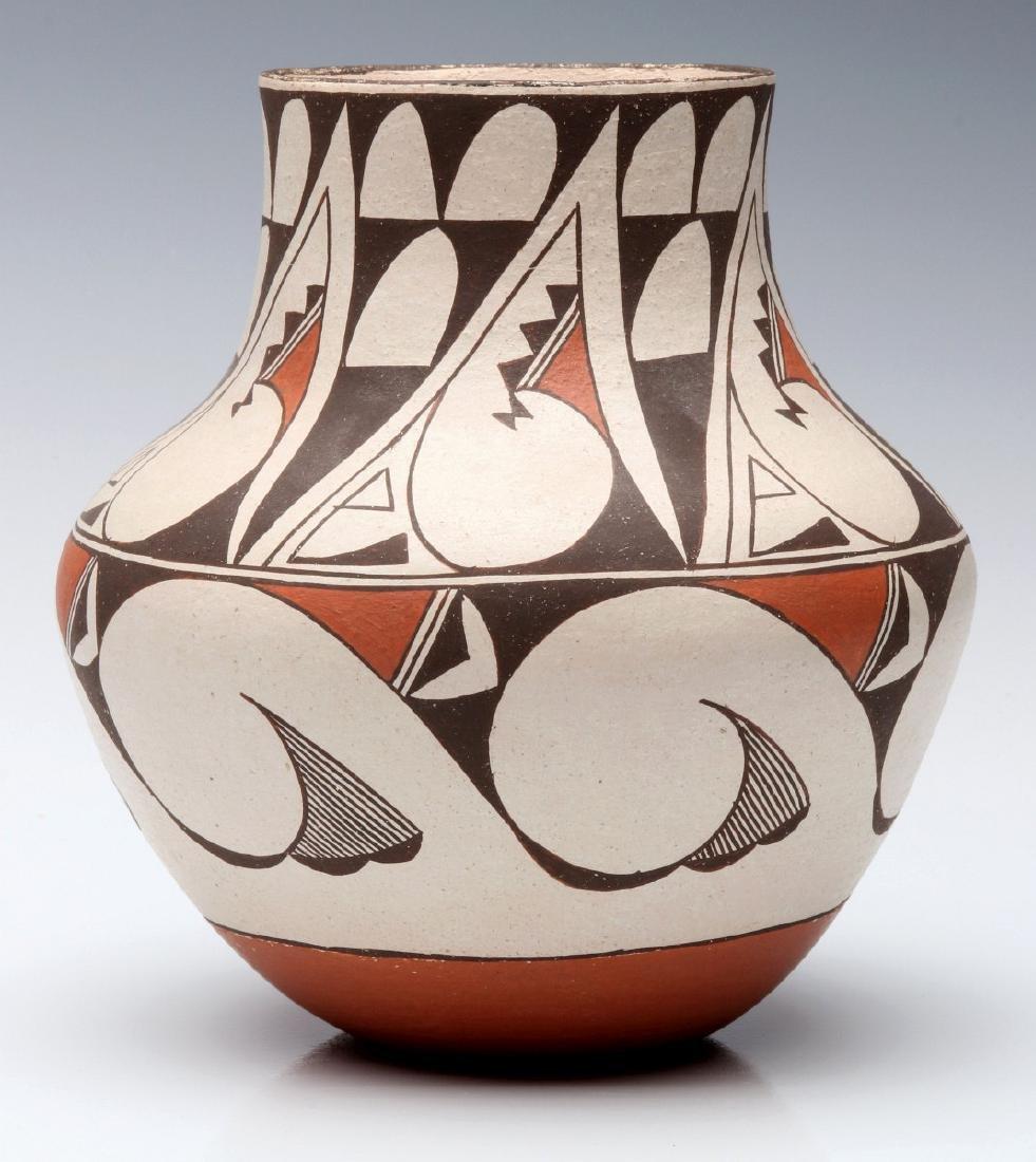 A LAGUNA PUEBLO POTTERY JAR SIGNED E. CHEROMIAH