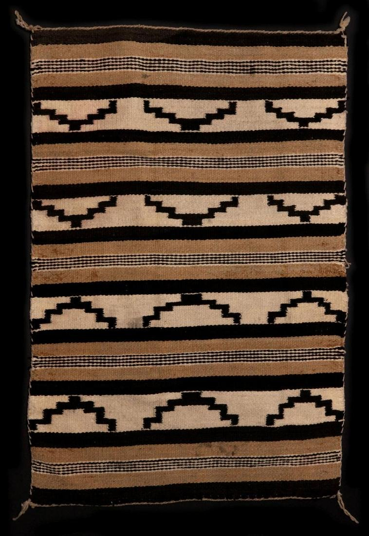 A LATE 20TH C. CHINLE NAVAJO WEAVING