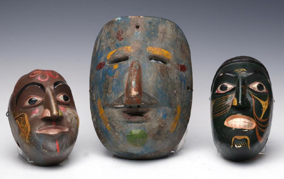A COLLECTION OF SOUTH AMERICAN CARVED WOOD MASKS