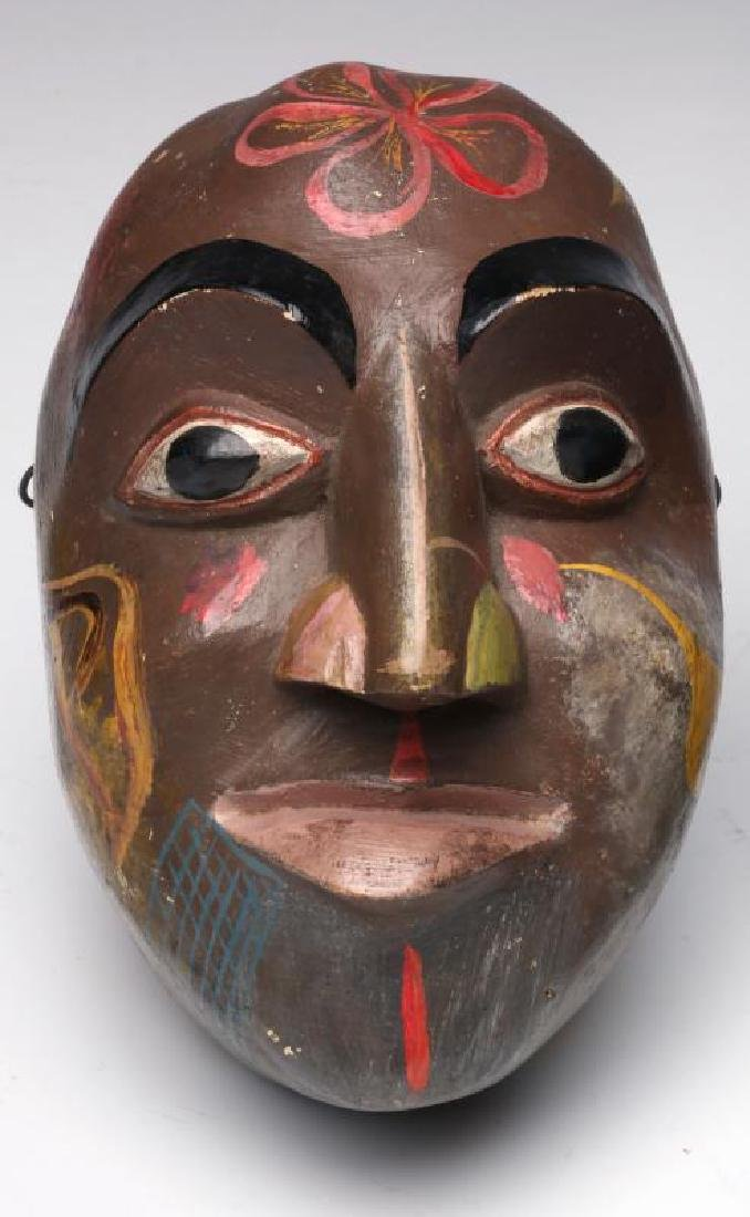 A COLLECTION OF SOUTH AMERICAN CARVED WOOD MASKS - 2