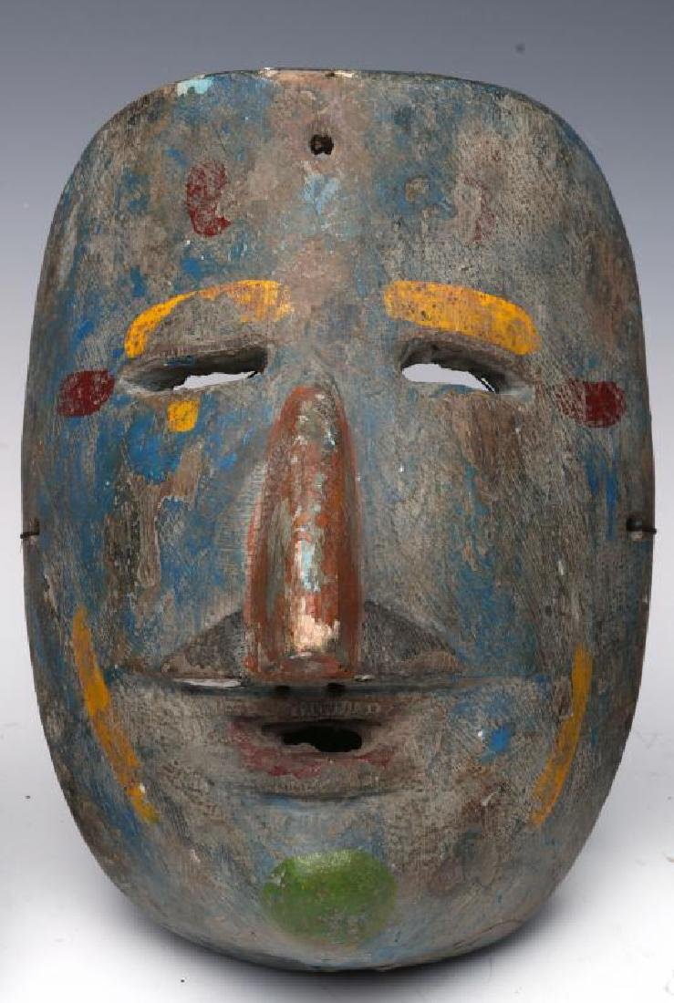 A COLLECTION OF SOUTH AMERICAN CARVED WOOD MASKS - 3