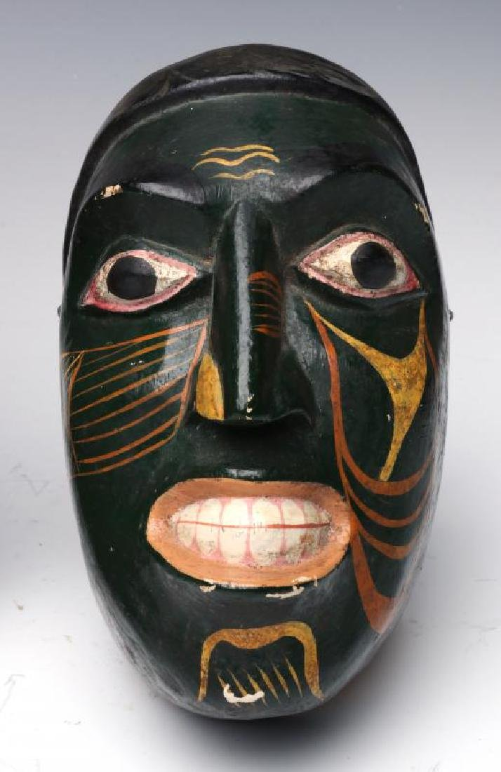 A COLLECTION OF SOUTH AMERICAN CARVED WOOD MASKS - 4