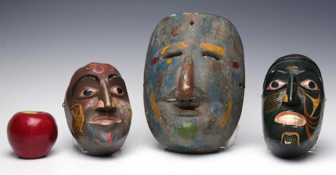 A COLLECTION OF SOUTH AMERICAN CARVED WOOD MASKS - 5