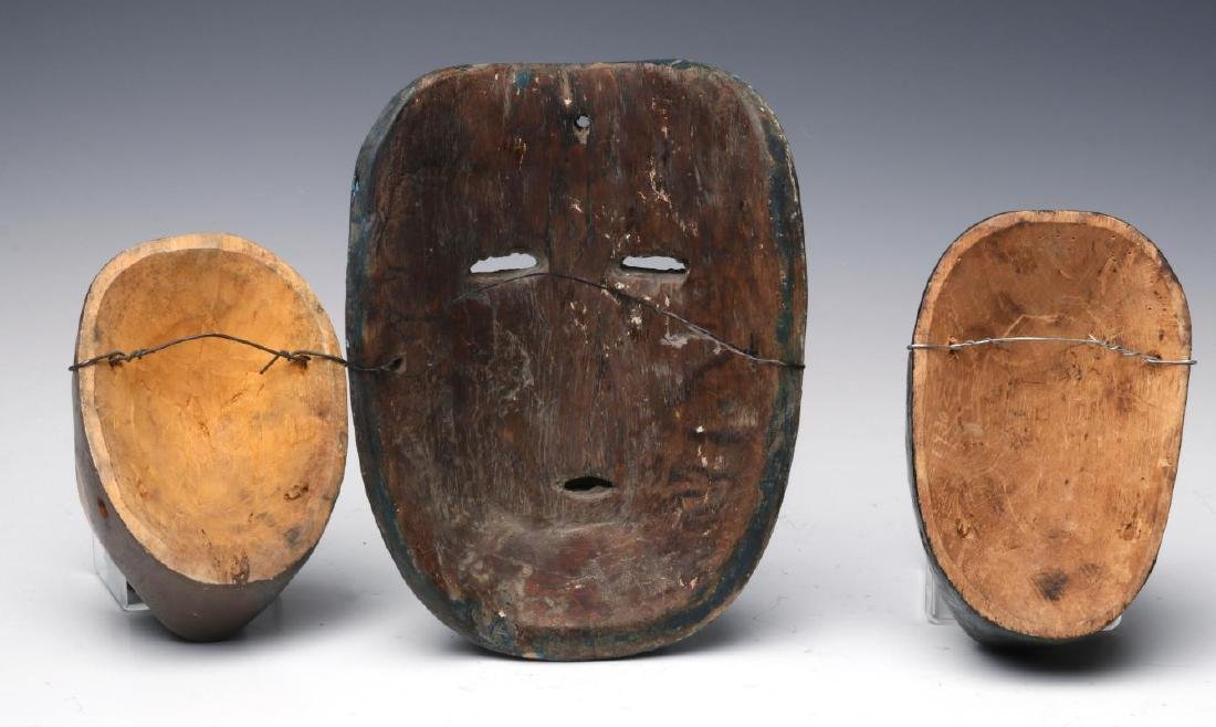 A COLLECTION OF SOUTH AMERICAN CARVED WOOD MASKS - 6