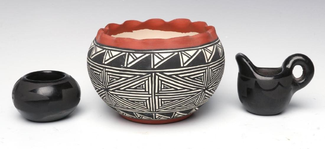 A COLLECTION OF SANTA CLARA AND ACOMA POTTERY