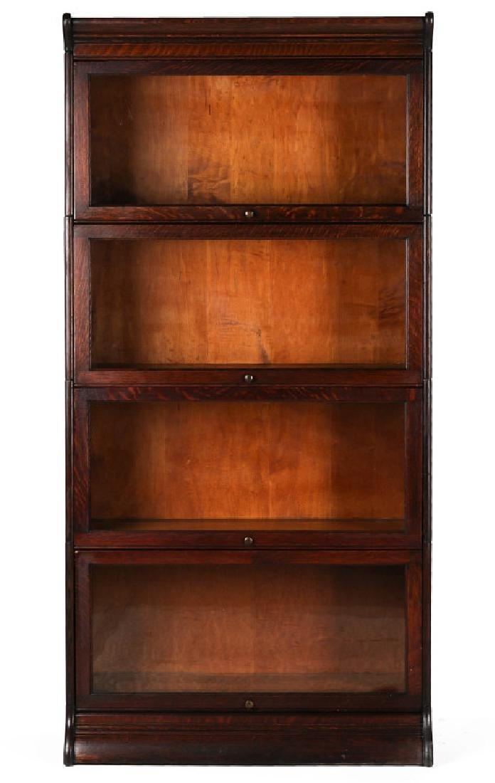 AN ANTIQUE FOUR STACK OAK BARRISTER'S BOOK CASE