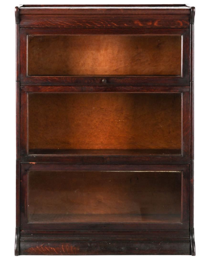 AN ANTIQUE THREE STACK OAK BARRISTER'S BOOK CASE