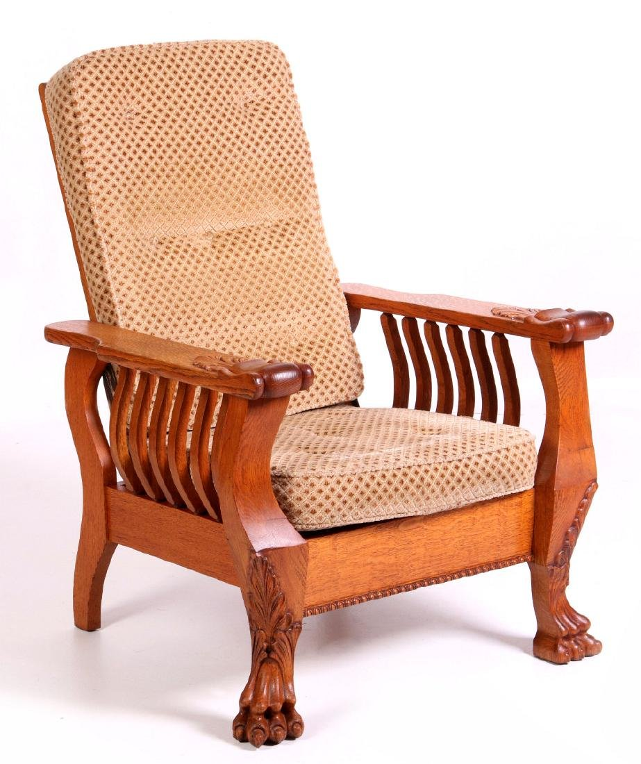 A HEAVY OAK PAW FOOT MORRIS CHAIR CIRCA 1900