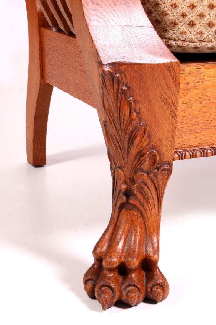 A HEAVY OAK PAW FOOT MORRIS CHAIR CIRCA 1900 - 3