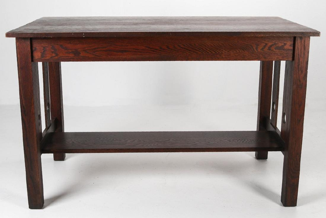 AN OAK ARTS & CRAFTS LIBRARY TABLE CIRCA 1910 - 5