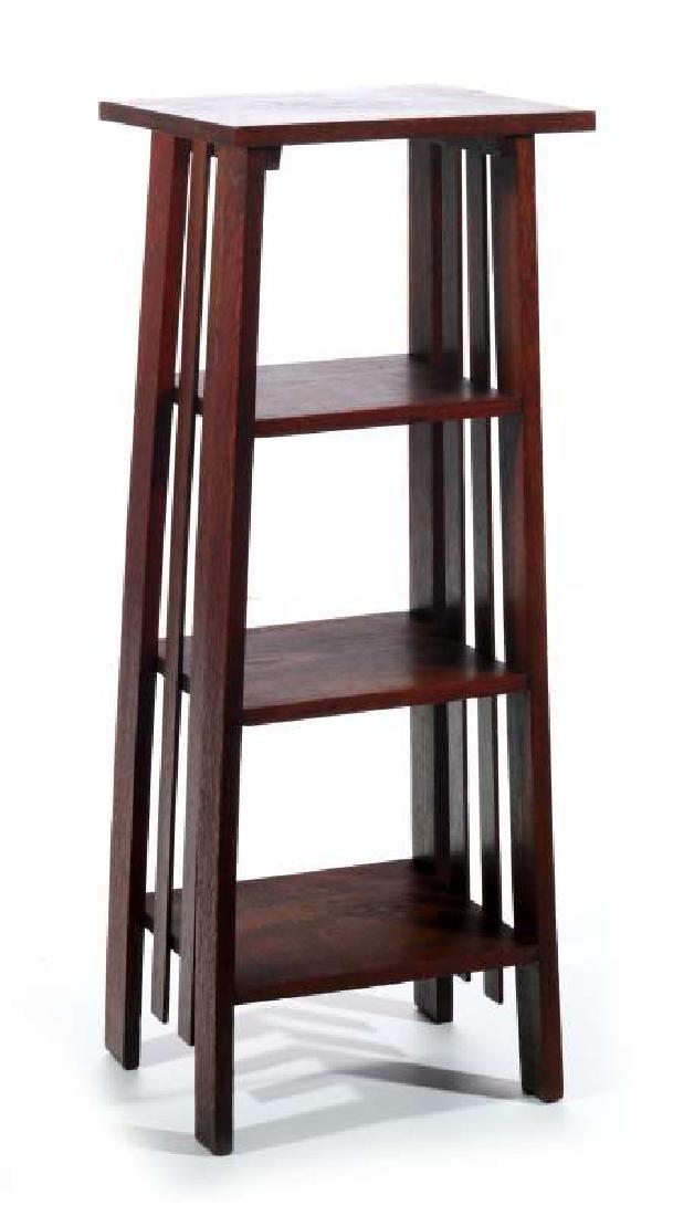 A CIRCA 1900 OAK ARTS AND CRAFTS MAGAZINE STAND