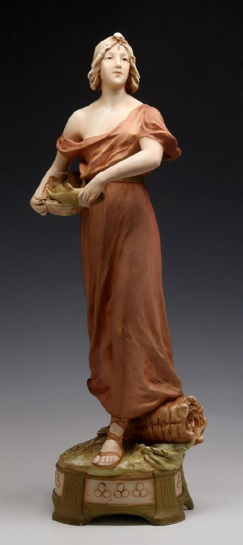 A ROYAL DUX FIGURE OF A WOMAN WITH FISH