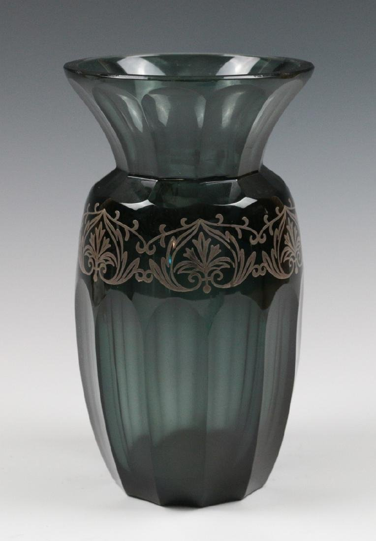 A BOHEMIAN POLISHED GLASS VASE WITH SILVER OVERLAY