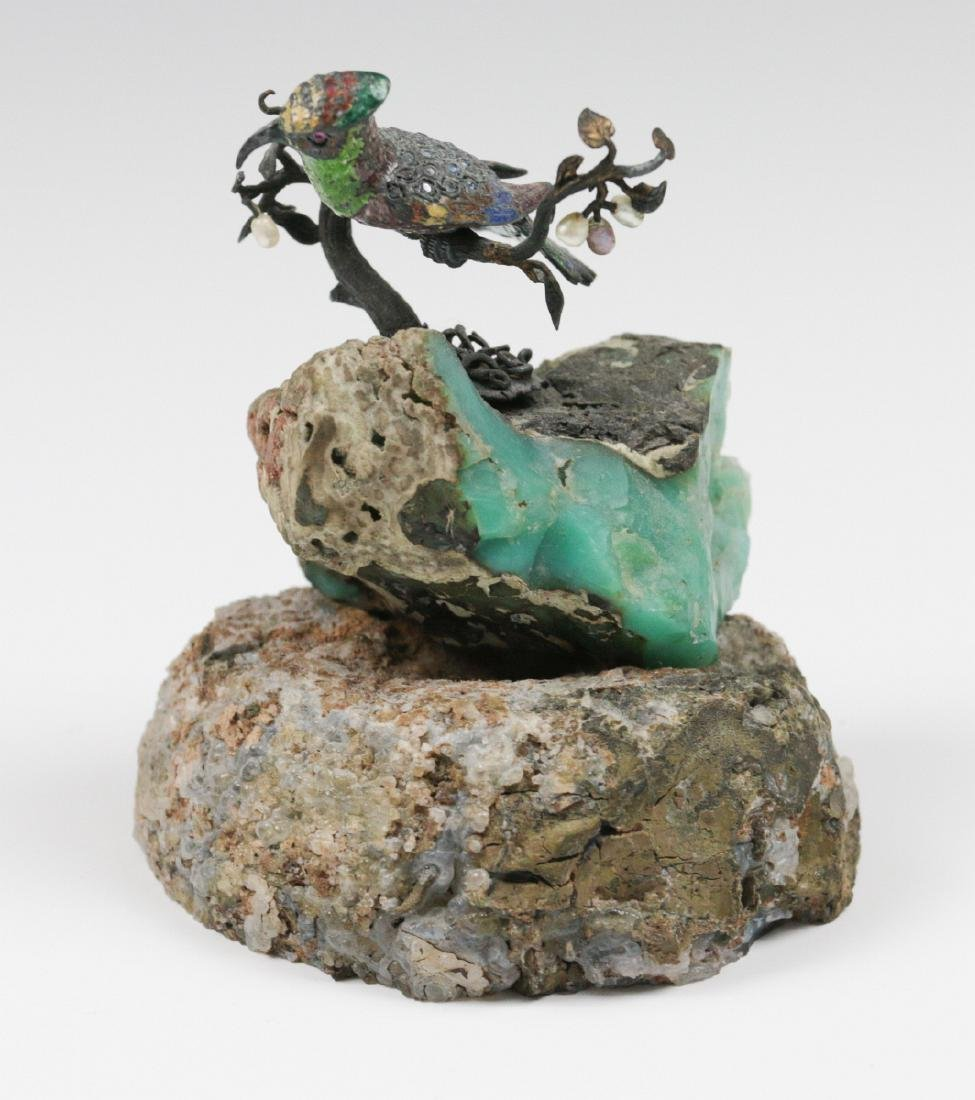 A SMALL EMBELLISHED BRONZE FIGURE ON GEODE - 5