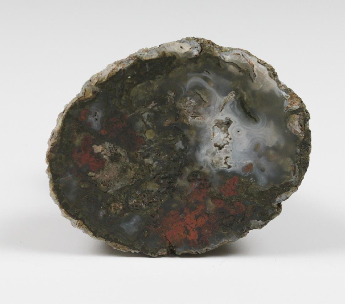 A SMALL EMBELLISHED BRONZE FIGURE ON GEODE - 8