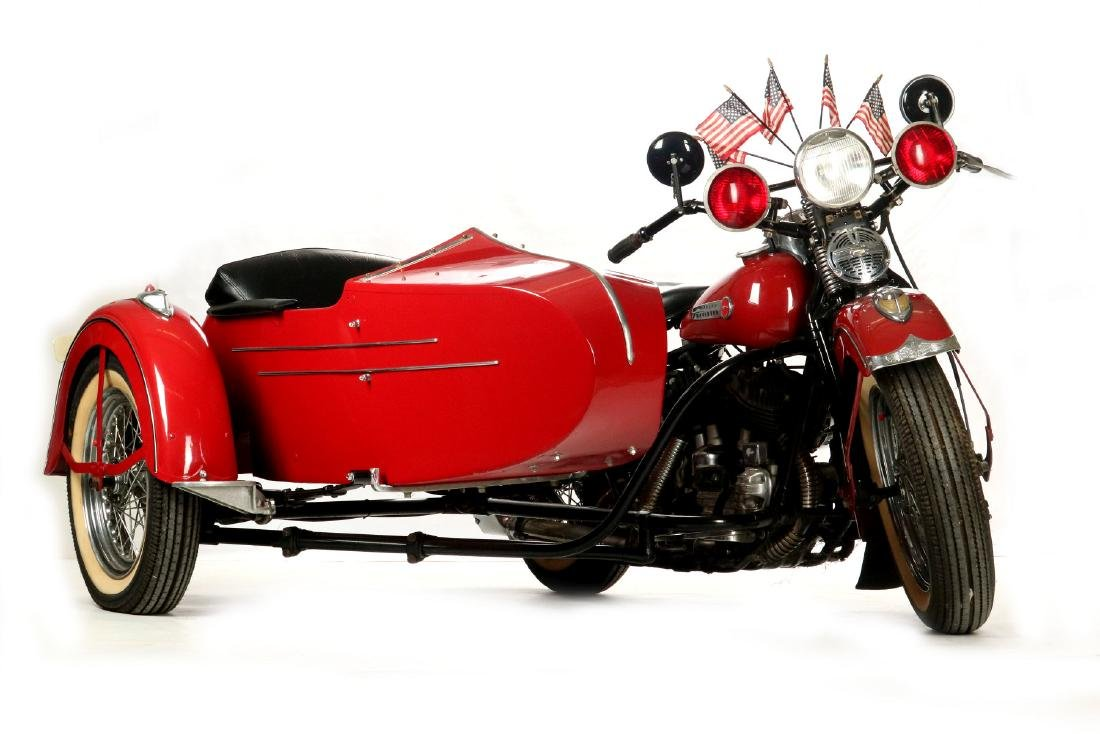 A 1948 HARLEY DAVIDSON MOTORCYCLE WITH SIDECAR