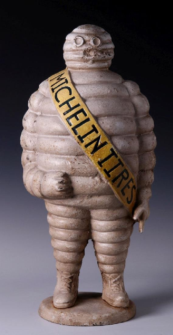 A CAST IRON MICHELIN TIRES ADVERTISING FIGURE