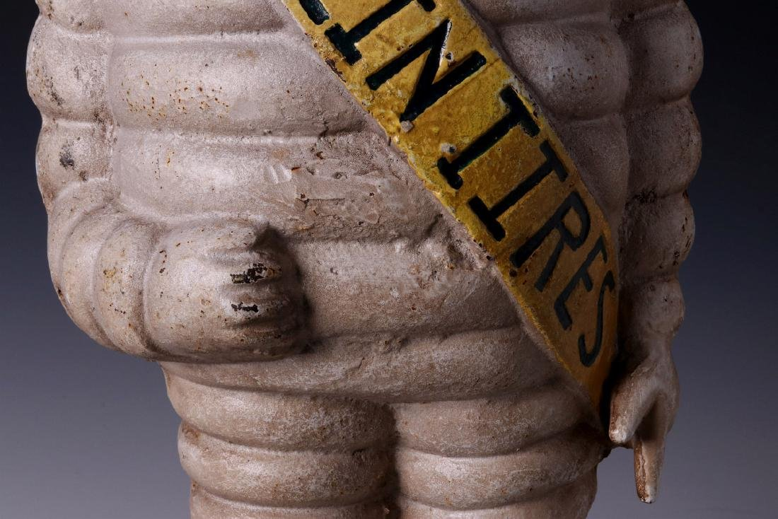 A CAST IRON MICHELIN TIRES ADVERTISING FIGURE - 5