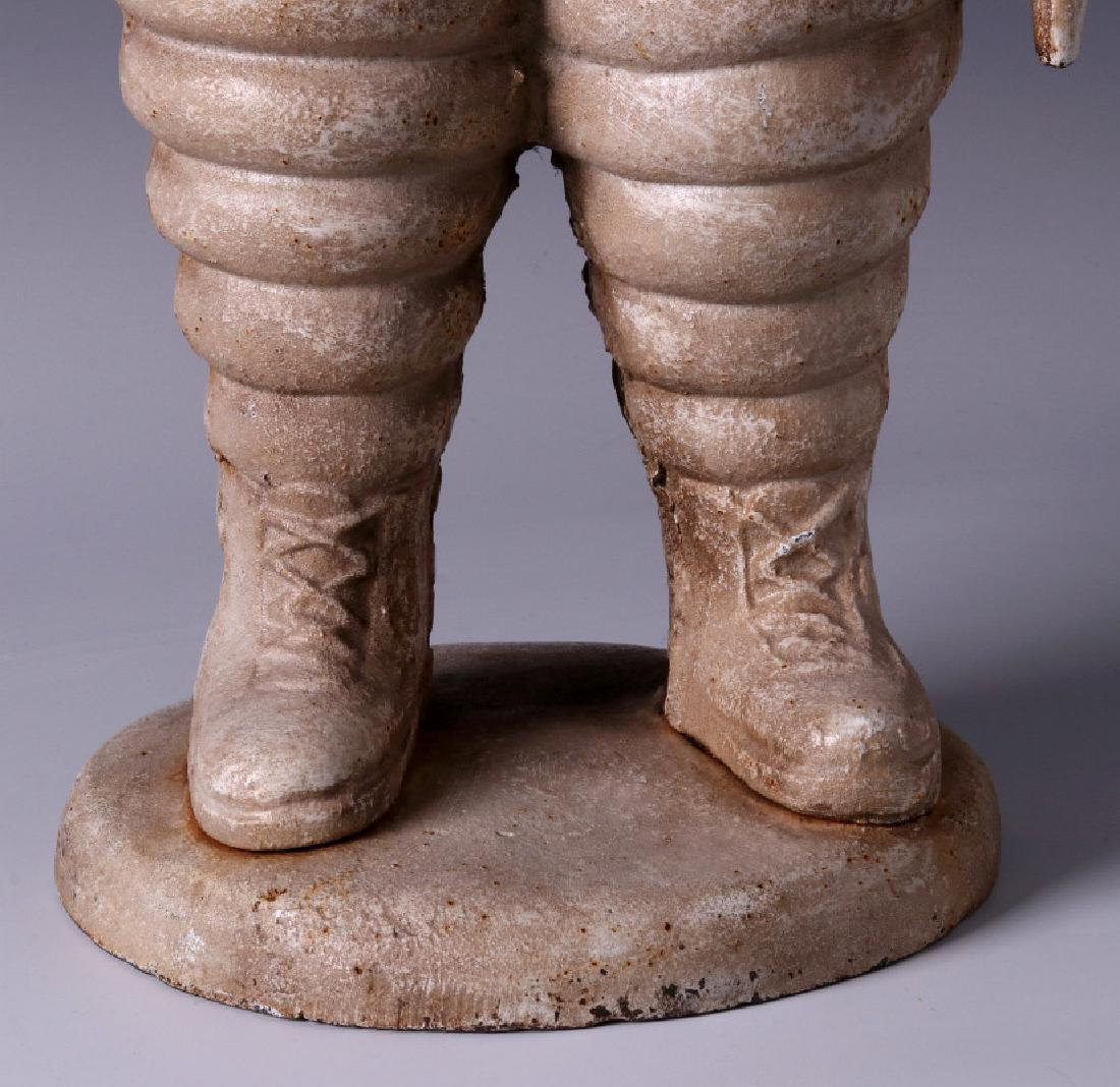A CAST IRON MICHELIN TIRES ADVERTISING FIGURE - 6