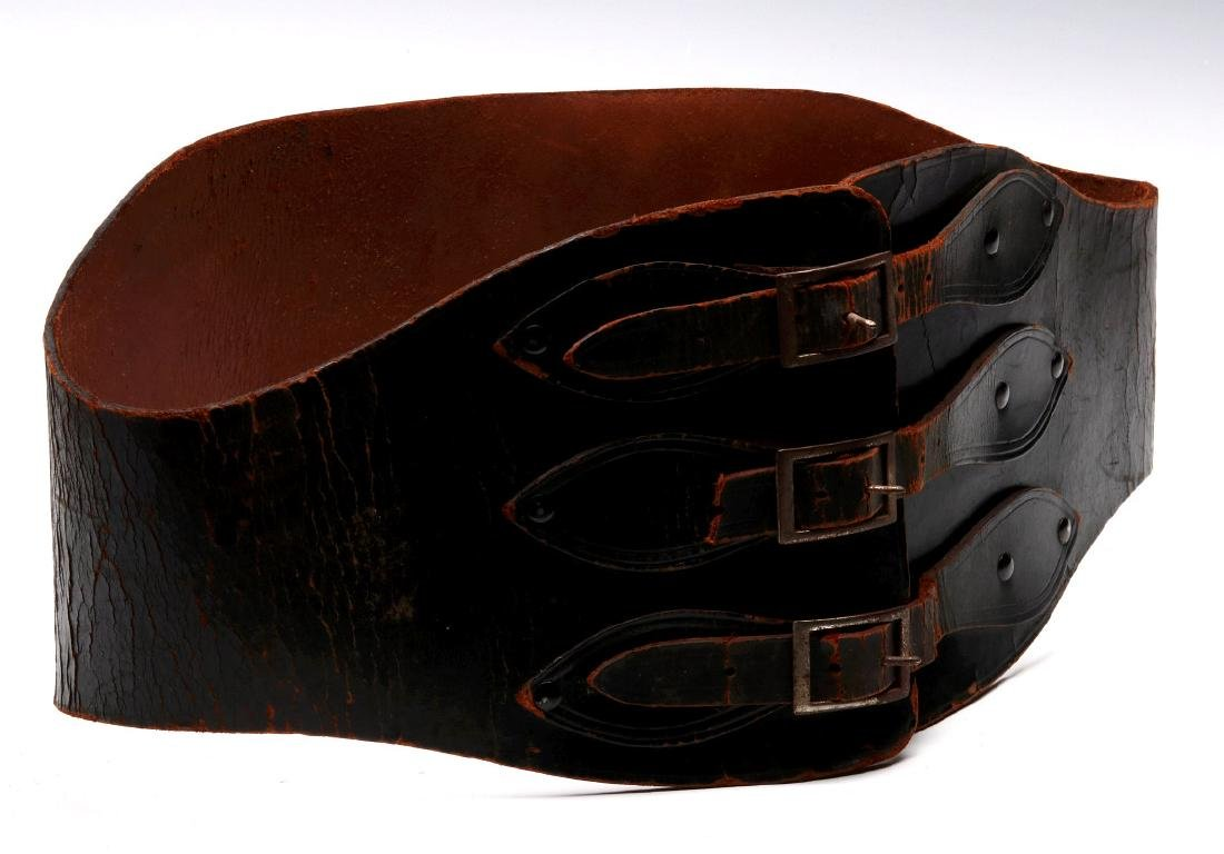 A VINTAGE LEATHER MOTORCYCLE RIDER'S BELT