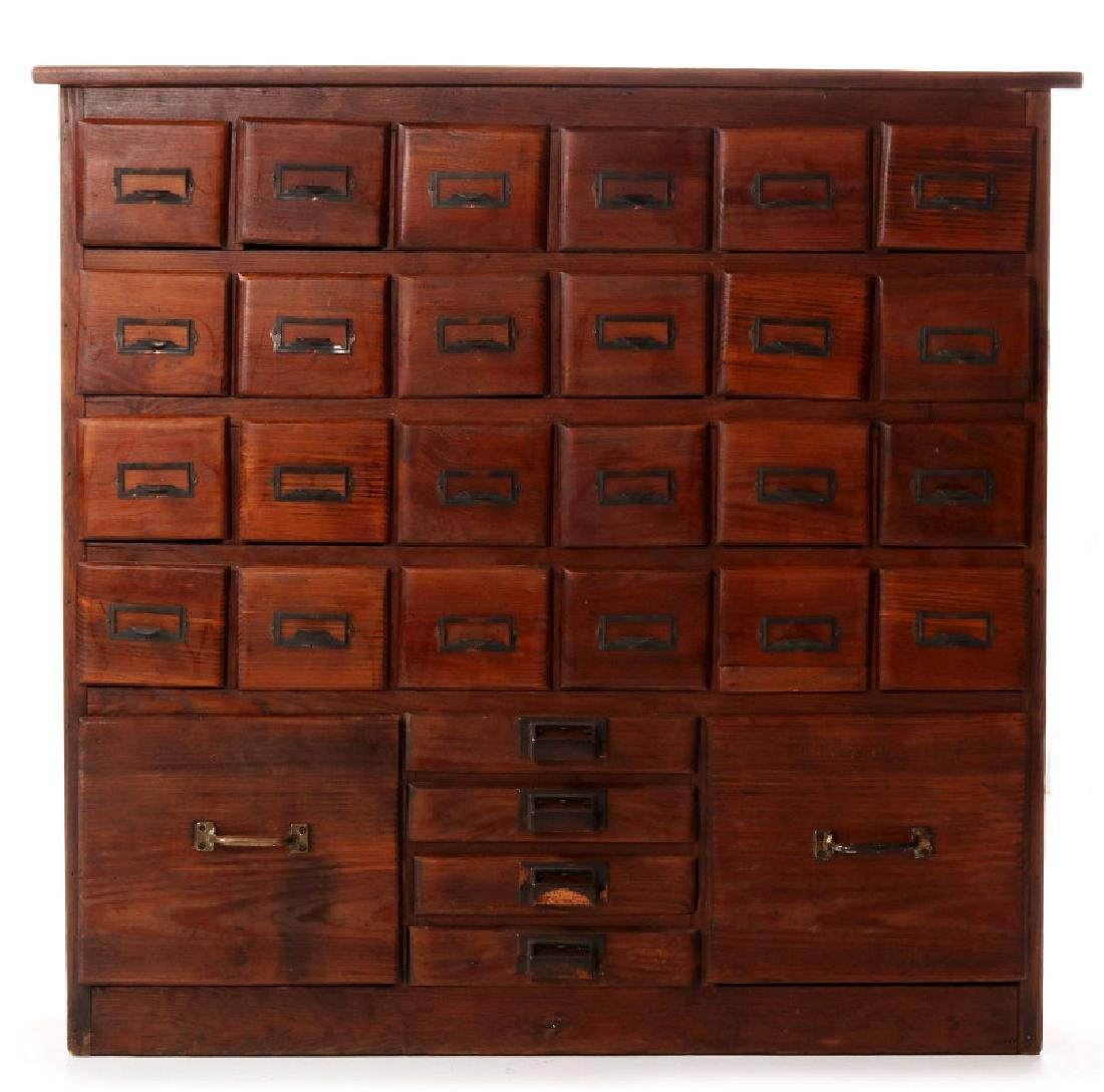 A MULTI-DRAWER YELLOW PINE STORE CABINET C. 1920