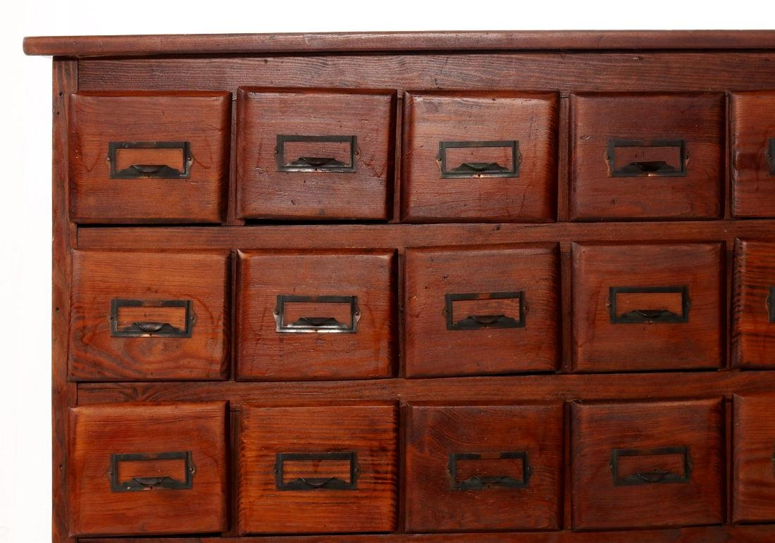 A MULTI-DRAWER YELLOW PINE STORE CABINET C. 1920 - 2