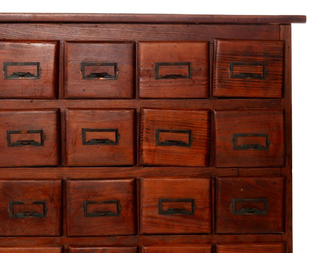 A MULTI-DRAWER YELLOW PINE STORE CABINET C. 1920 - 3