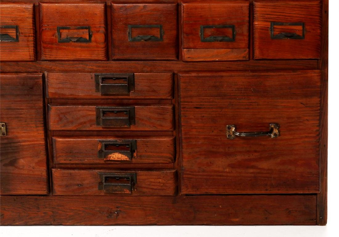 A MULTI-DRAWER YELLOW PINE STORE CABINET C. 1920 - 4