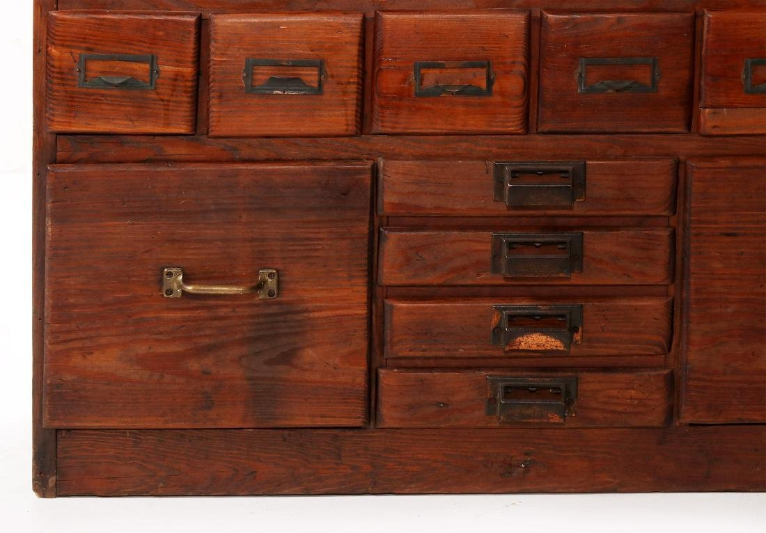 A MULTI-DRAWER YELLOW PINE STORE CABINET C. 1920 - 5