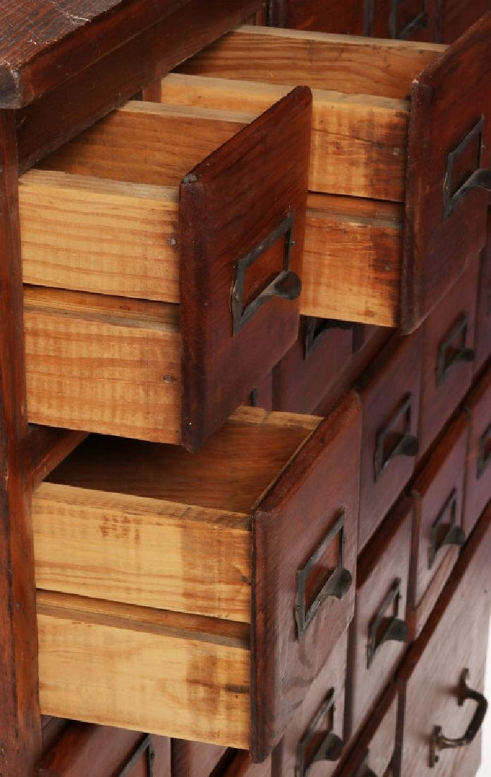 A MULTI-DRAWER YELLOW PINE STORE CABINET C. 1920 - 6